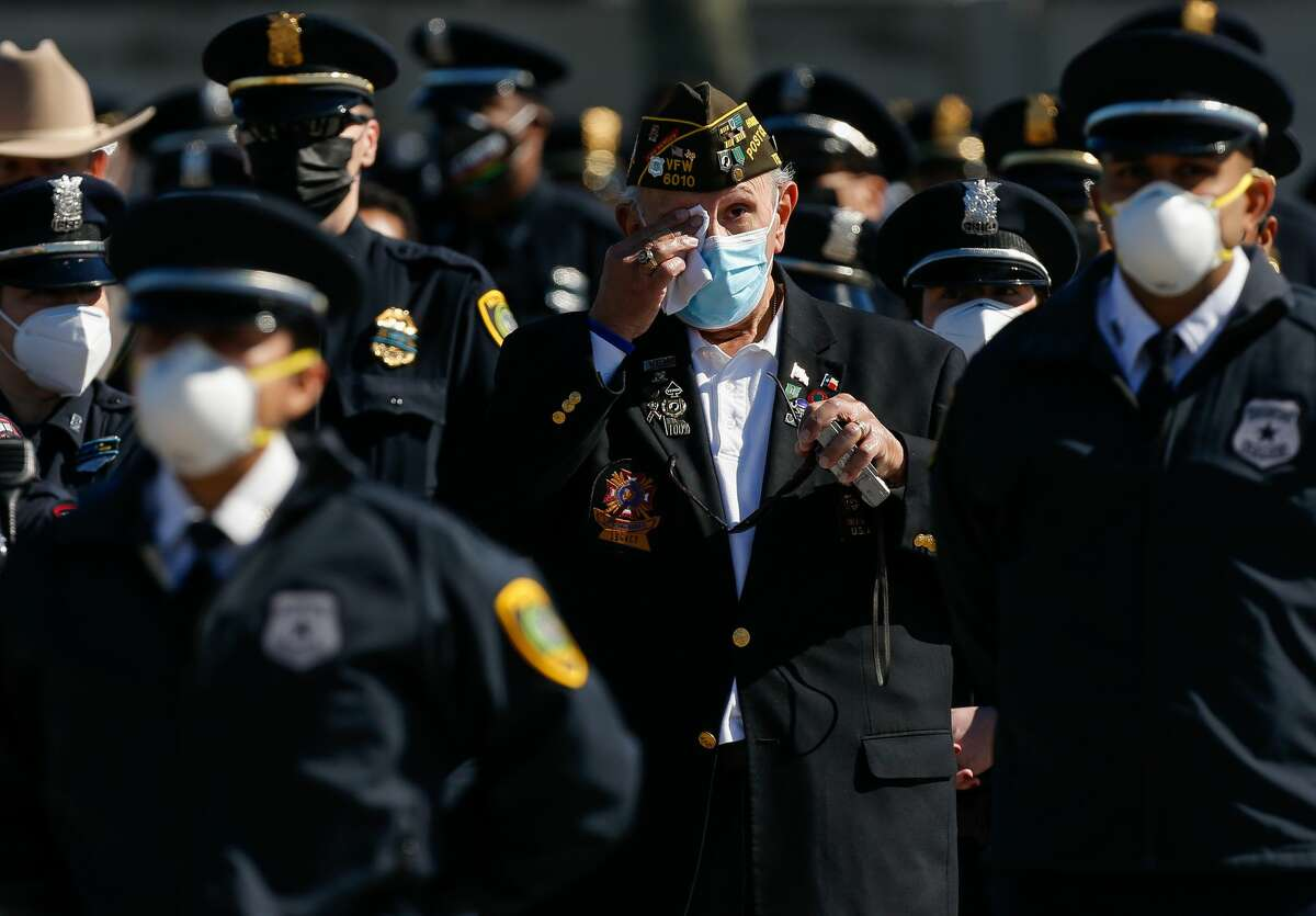 A veteran wipes away tears during the memorial service for Houston Police Sgt Harold Preston at Grace Church Houston on Thursday, Oct. 29, 2020, in Houston.