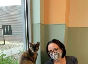 Ashley Putz and Delicata adoption picture.