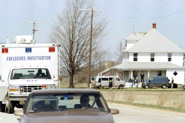 ATF and FBI agents leave the James Nichols farm in Decker, Mich., April 24, 1995, after four days of searching for evidence in the bombing of the Alfred P. Murrah federal building in Oklahoma City, Okla. (AP Photo/Jeff Kowalsky) NO SALES