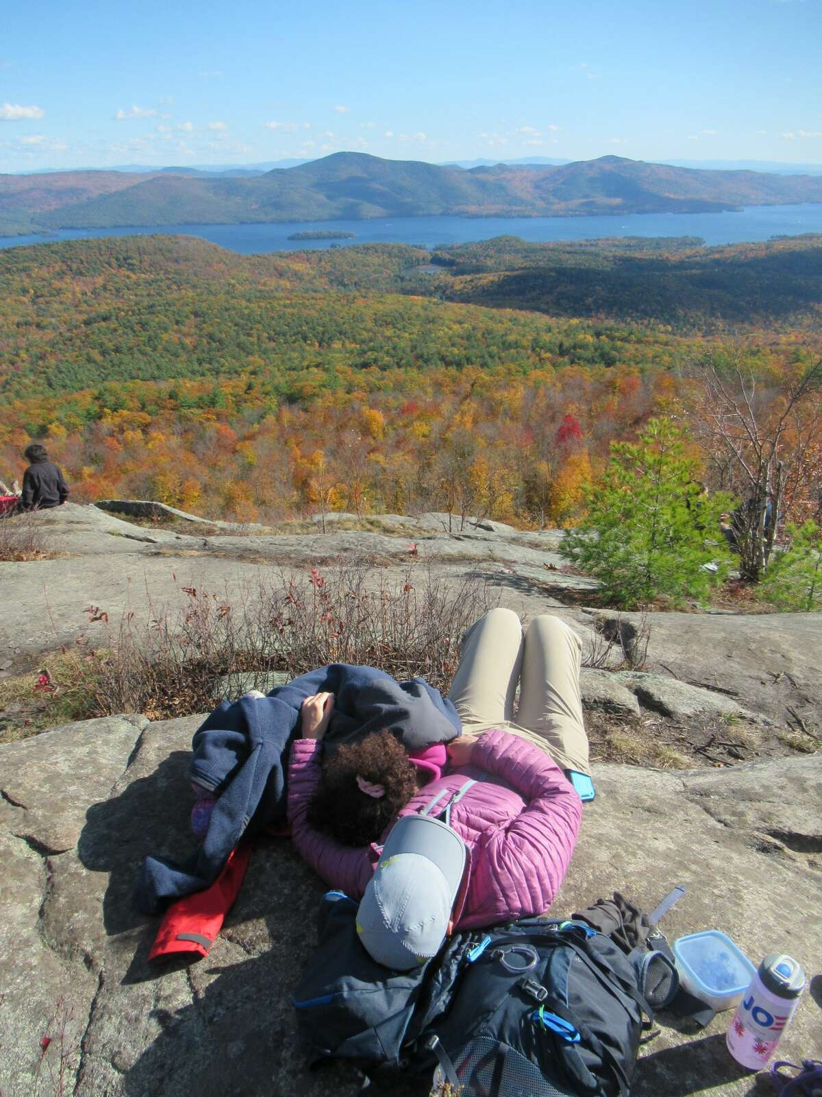 Outdoors writer Gillian Scott and her daughter relax in the sun on the summit of Cat Mountain during a recent hike. (Herb Terns / Times Union)