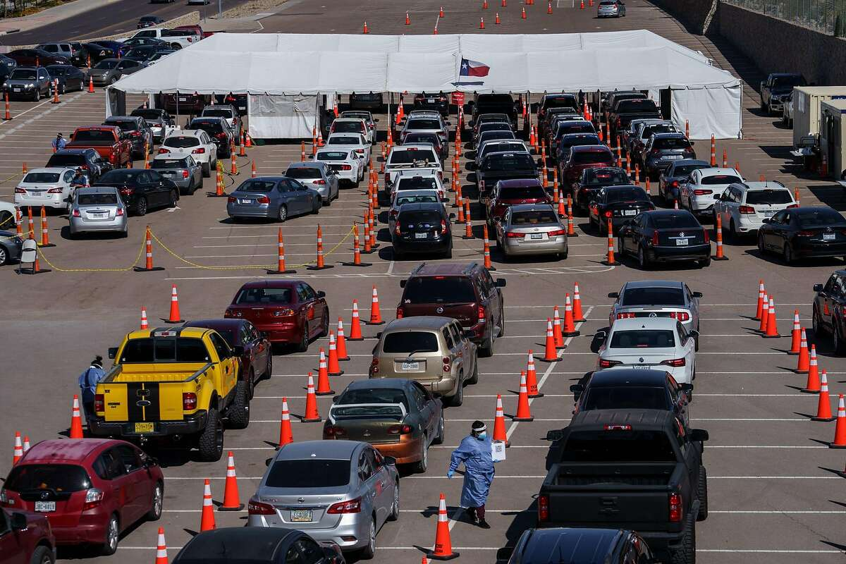 Motorists line up for coronavirus tests at the University of El Paso. That city is a hot spot.