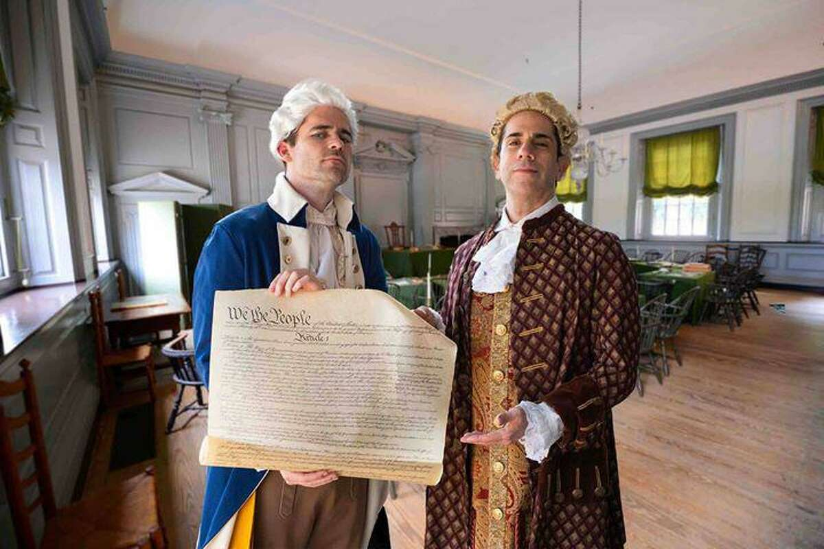 """Pictured are Dustin Bass, left, and Alan Wakim, right, dressed as historical figures for their """"Sons of History"""" podcasts and video segments. The history enthusiasts seek to educate and entertain on a variety of historical and political topics."""