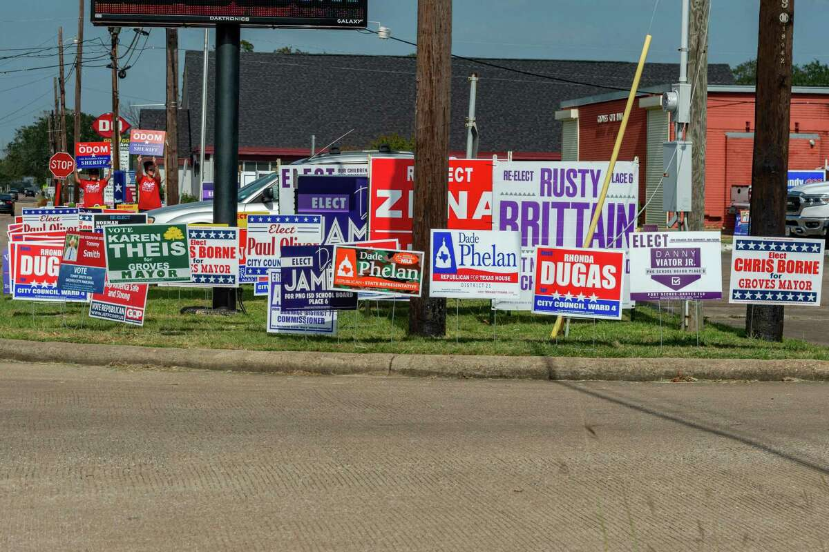 Political signs sit outside the Groves Recreation Center. Tuesday was the first day of early voting in Texas and manypeople came out to do their civic duty throughout Jefferson County. Photo made on October 12, 2020. Fran Ruchalski/The Enterprise