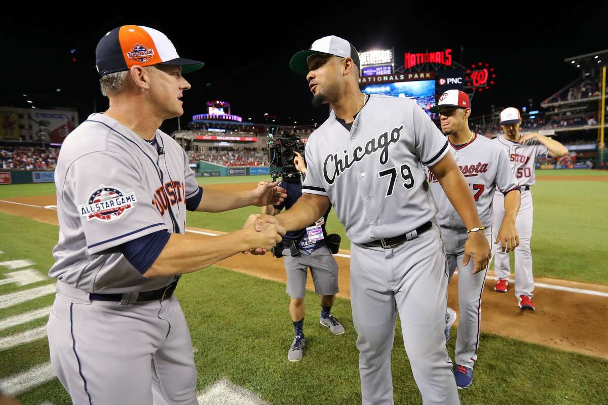 WASHINGTON, D.C. - JULY 17: Manager AJ Hinch #14 of the Houston Astros celebrates with Jose Abreu #79 of the Chicago White Sox after defeating the National League 8-6 in the 89th MLB All-Star Game at Nationals Park on Tuesday, July 17, 2018 in Washington, D.C. (Photo by Alex Trautwig/MLB via Getty Images)