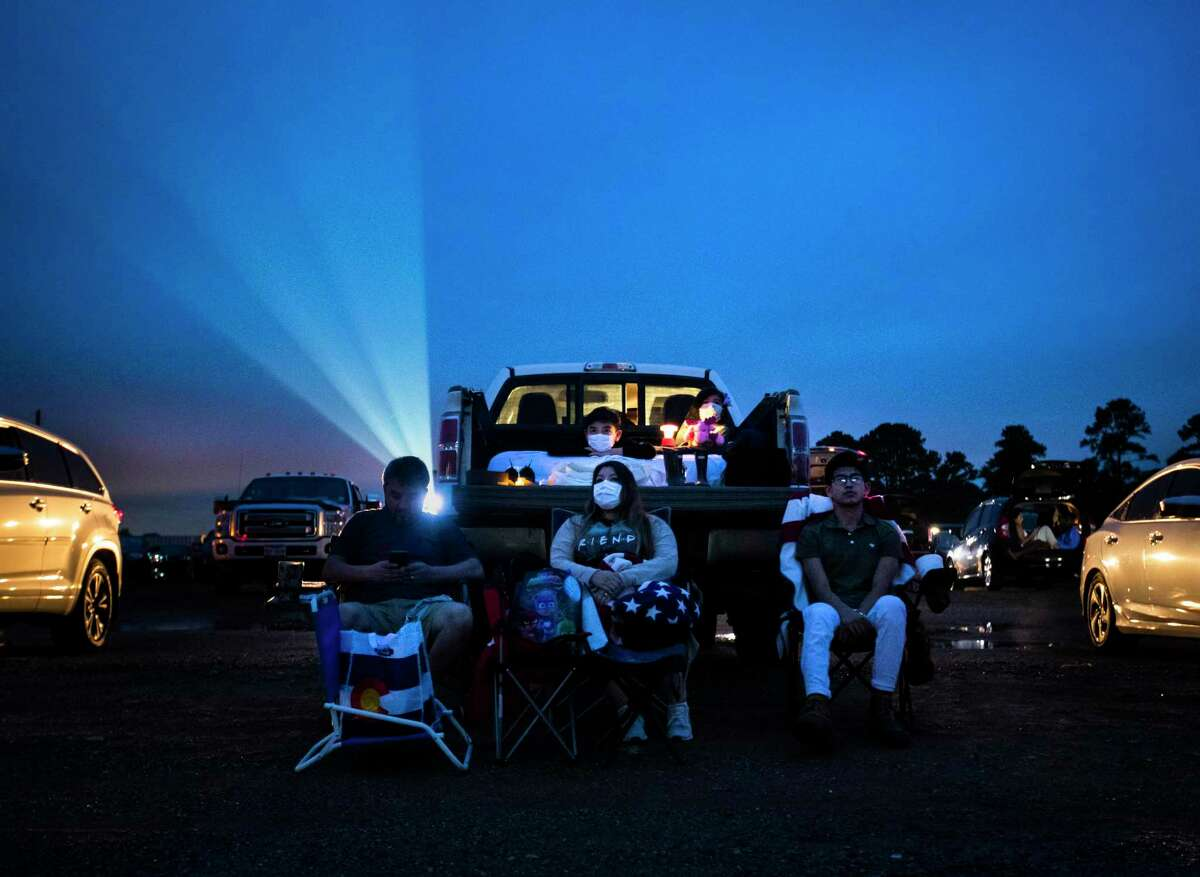 Adam Hernandez, 43, Kristie Hernandez, 41, Sonny Reyes, 19, Andrew Hernandez, 12, and Lily Hernandez, 7, get in place and ready to watch The Vast of Night together at the Showboat Drive-In Theater Friday, May 15, 2020, in Hockley.