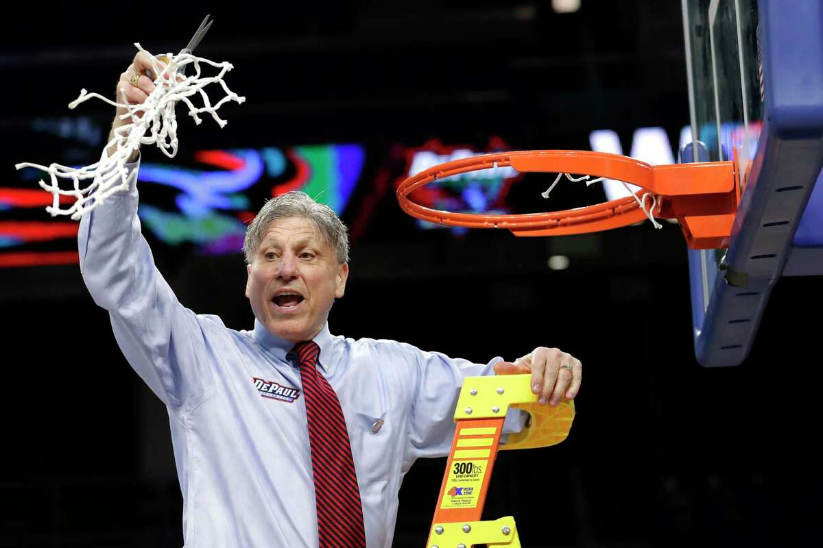 DePaul head coach Doug Bruno reacts while cutting down the net after a win over Marquette in an NCAA college basketball game in the Big East women's tournament final, Monday, March 9, 2020, in Chicago. (AP Photo/Nam Y. Huh)
