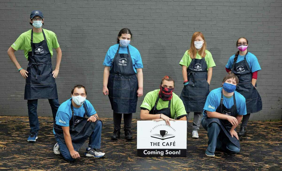 Seven of the nine employees who will work at the new cafe at Greenwich Library are pictured. The new competitive employment opportunity will offer people with disabilities meaningful employment, nonprofit leaders at Greenwich-based Abilis said.