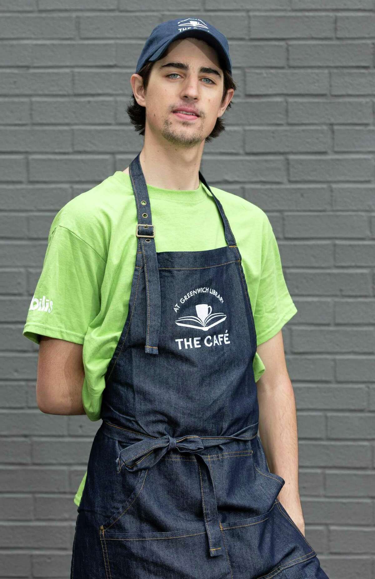 Harrison Peloso, 24, will be one of nine people with disabilities to work in a new employment opportunity at the Greenwich Library Cafe once it opens in November.