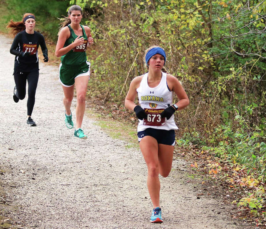 Roxana's Zoey Losch (front) emerges from the Loveless Park woods during the Nos. 1-2 heat at the Carlinville Class 1A Regional last Saturday in Carlinville. Losch, who finished 11th in a personal-best time, joins her teammates in Forsyth on Saturday for the Decatur St. Teresa Sectional at Hickory Point golf course. Photo: Greg Shashack / The Telegraph