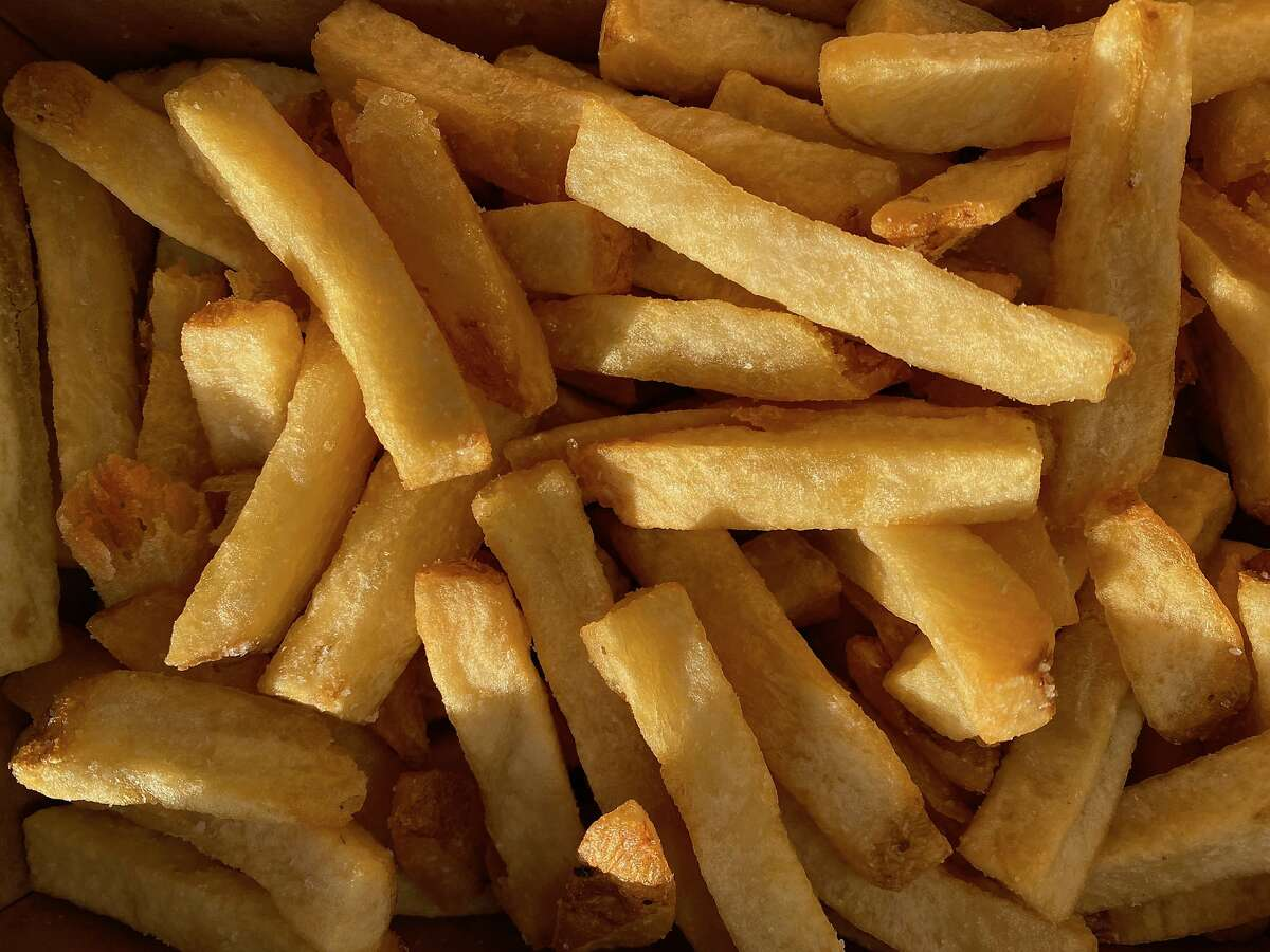 French fries from Quik Dog, the pandemic pivot of renowned cocktail bar Trick Dog, are cooked three times.