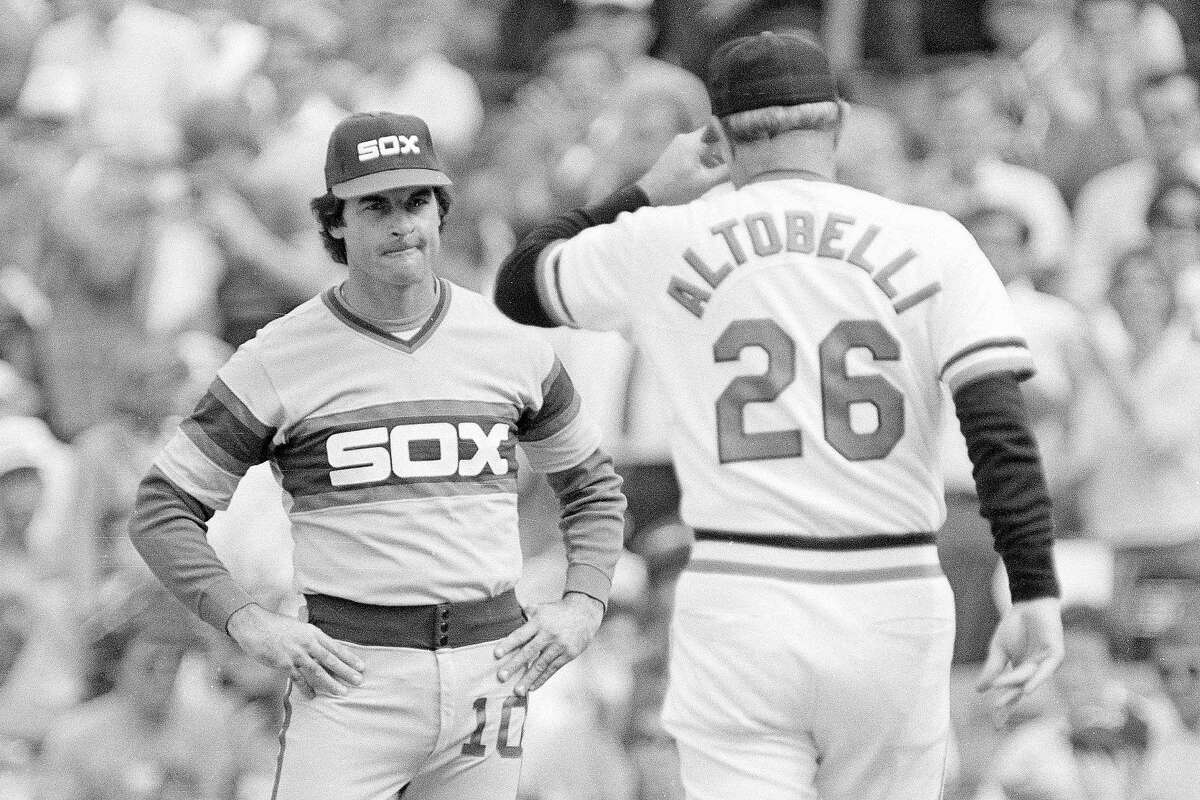 In this Oct. 5, 1983, file photo, Chicago White Sox manager Tony La Russa, left, reacts as he meets Baltimore Orioles manager Joe Altobelli before the start of their American League baseball playoff game at Memorial Stadium in Baltimore. La Russa, the Hall of Famer who won a World Series championship with the Oakland Athletics and two more with the St. Louis Cardinals, is returning to manage the Chicago White Sox 34 years after they fired him, the team announced Thursday, Oct. 29, 2020.