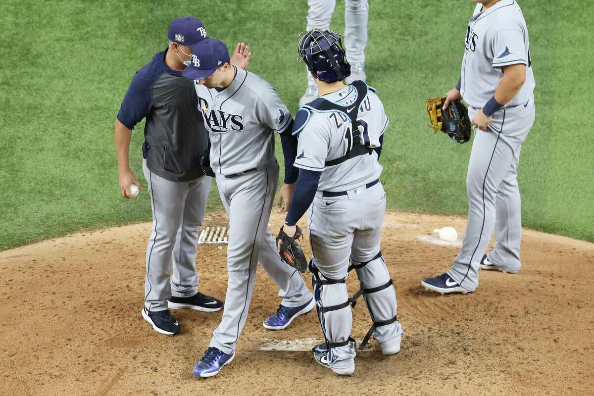 ARLINGTON, TEXAS - OCTOBER 27: Blake Snell #4 of the Tampa Bay Rays is taken out of the game by manager Kevin Cash during the sixth inning against the Los Angeles Dodgers in Game Six of the 2020 MLB World Series at Globe Life Field on October 27, 2020 in Arlington, Texas. (Photo by Maxx Wolfson/Getty Images)