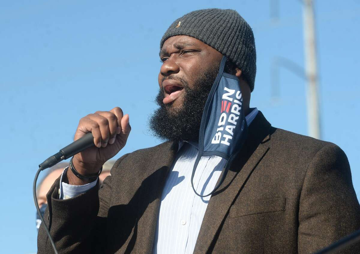 Constable Chris Bates sings the National Anthem at the Biden/Harris bus rally in Port Arthur Thursday morning. Several who attended the earlier rally in Beaumont joined the caravan following the bus for the Port Arthur stop. Photo taken Thursday, October 29, 2020 Kim Brent/The Enterprise