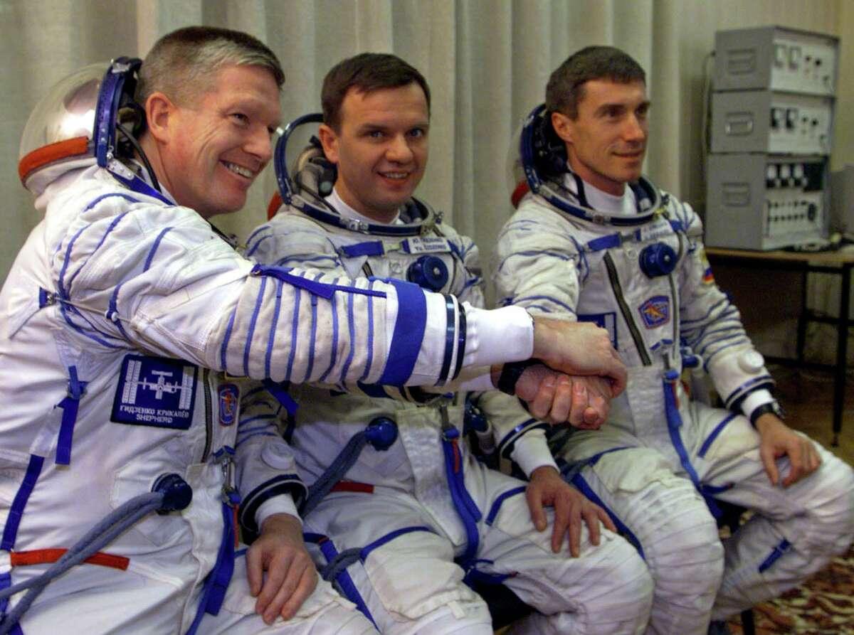 Russian cosmonauts Sergei Krikalev, right, Yuri Gidzenko and U.S. astronaut William Shepherd, left, before launching at the Baikonur cosmodrome, Tuesday, Oct. 31, 2000.