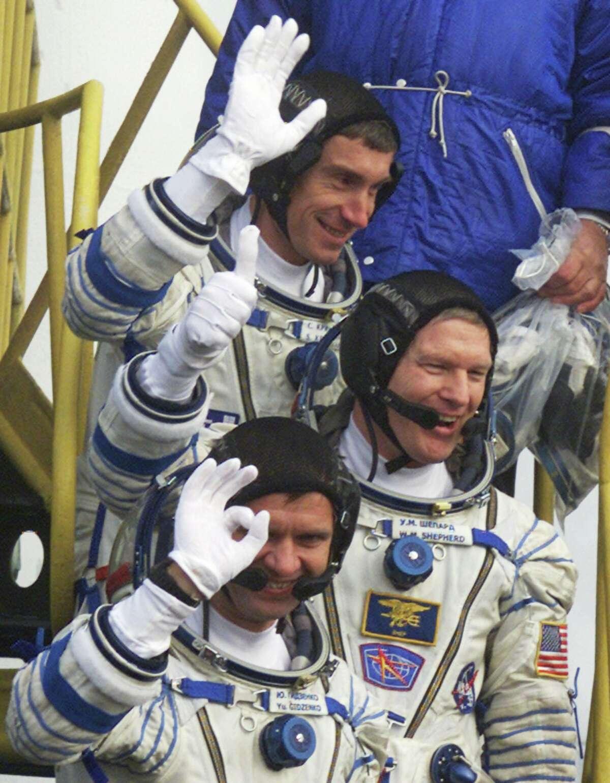 U.S. astronaut William Shepherd, center, and Russian cosmonauts Sergei Krikalev, top, and Yuri Gidzenko board the Soyuz in October 2000.