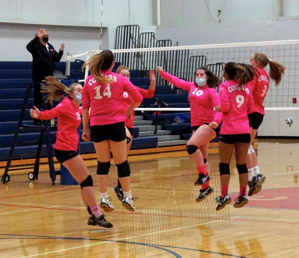 Members of the Crossroads Charter Academy volleyball team celebrate a serving ace during their win over Mason County Eastern in game one of a tri on Thursday evening in Big Rapids. (Pioneer photo/Joe Judd)
