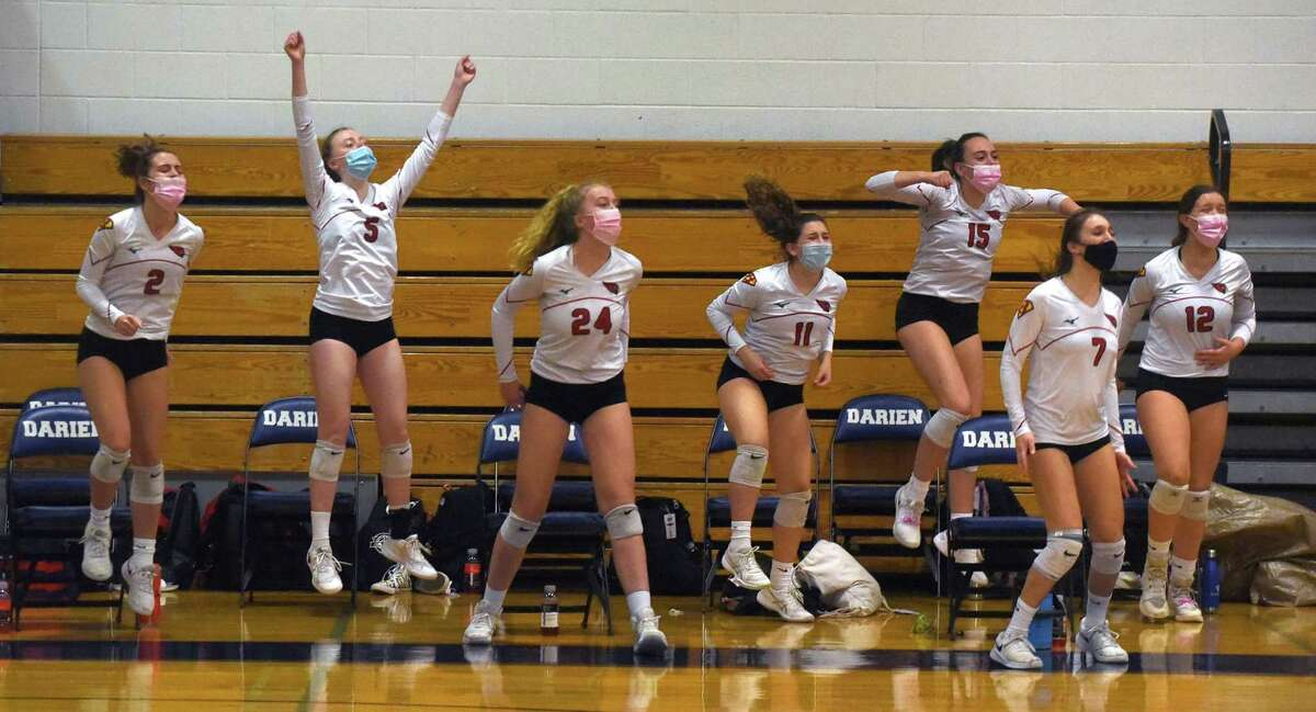 Greenwich players react to a point during the Cardinals' girls volleyball match at Darien on Thursday.