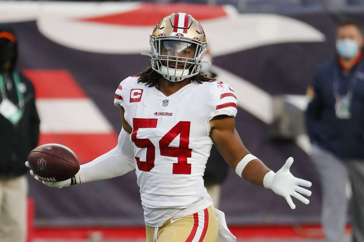 San Francisco 49ers linebacker Fred Warner returns an interception for a touchdown against the New England Patriots during an NFL football game at Gillette Stadium, Sunday, Oct. 25, 2020 in Foxborough, Mass. (Winslow Townson/AP Images for Panini)
