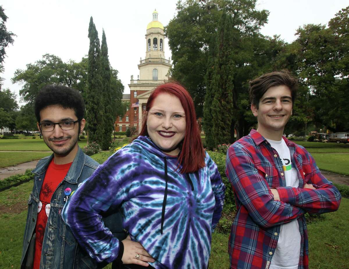 Gamma Alpha Upsilon members Alex Gonzalez, Shley Nitsche and Jake Picker stand in front of Baylor University's Pat Neff Hall. The group's latest push for an official chapters as a university student groups has the back of a Student Senate resolution and a student NAACP chapter. Campus. (Jerry Larson/Waco Tribune Herald)