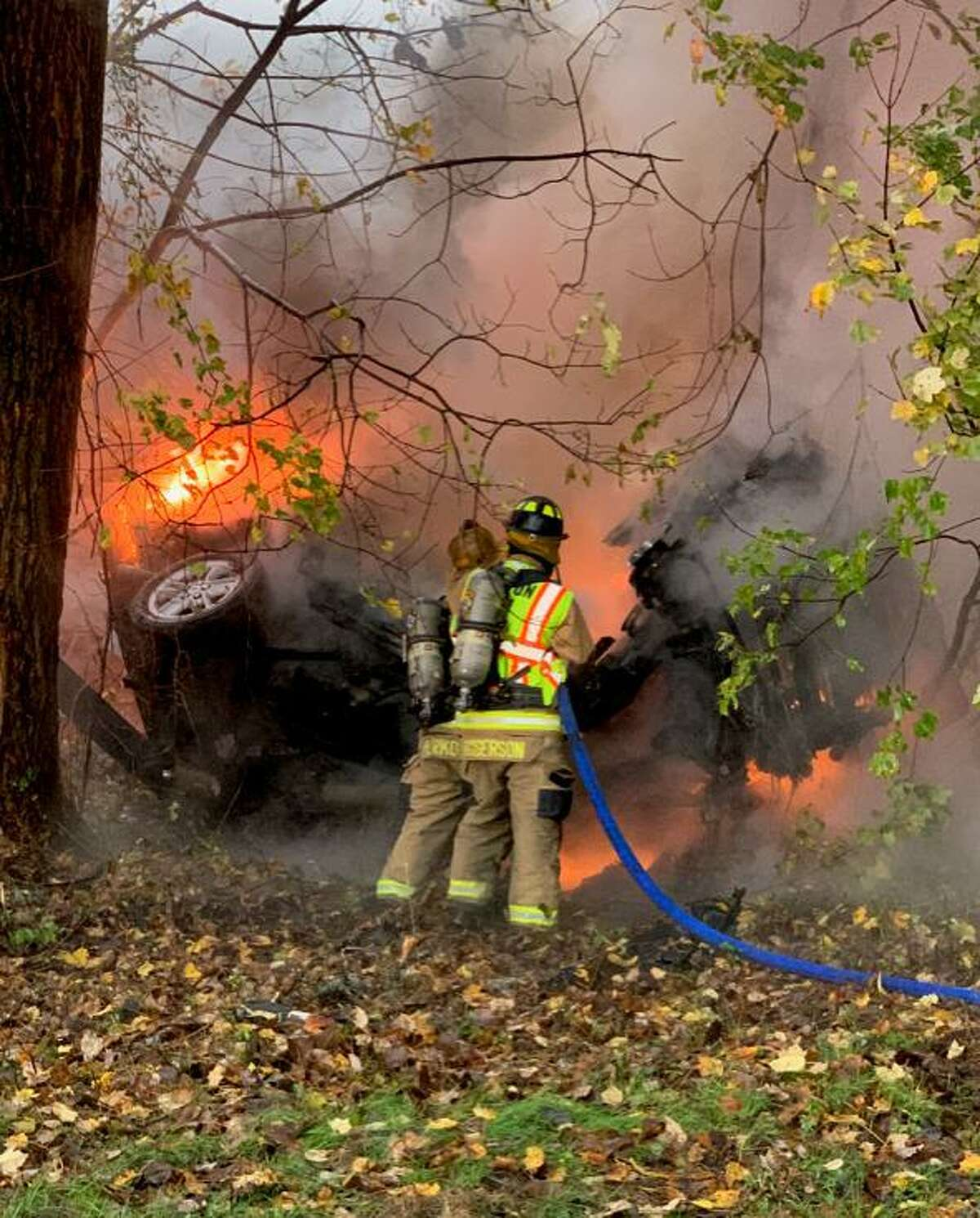 Shelton firefighters work on a car fire on Route 8 southbound between exits 12 and 13 on Thursday, Oct. 29.