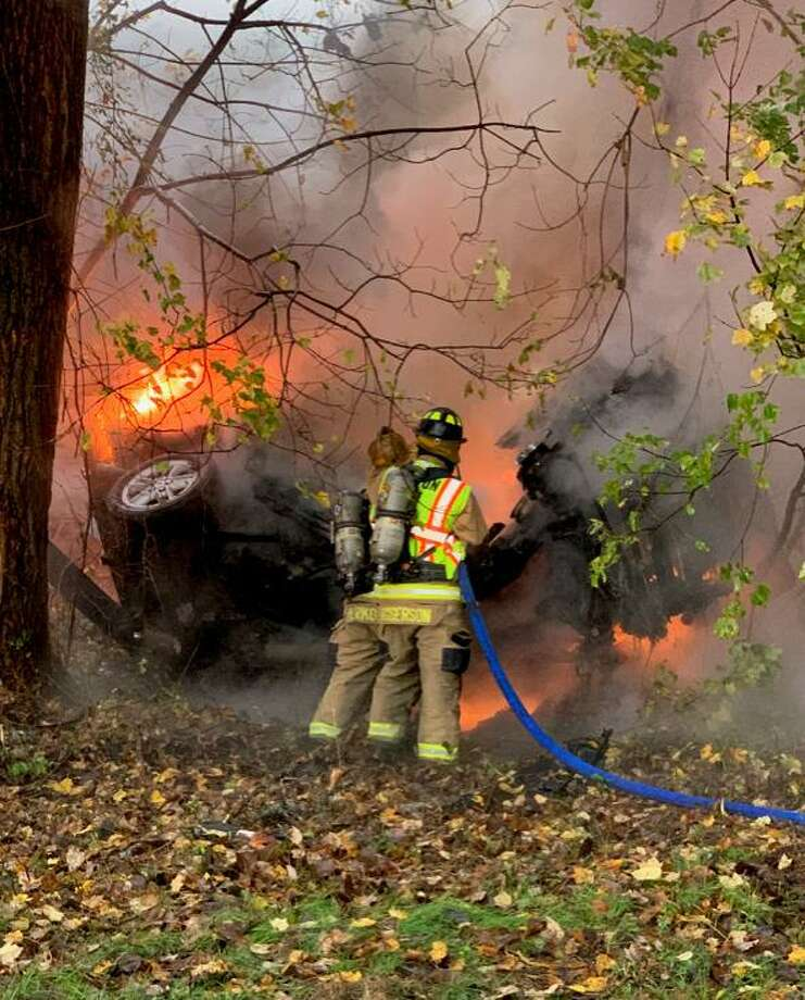 Shelton firefighters work on a car fire on Route 8 southbound between exits 12 and 13 on Thursday, Oct. 29. Photo: Shelton Fire Department / Contributed Photo / Connecticut Post