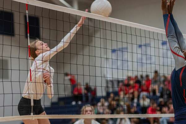 Lady Cardinal's Demi Carter (5) uses a soft touch to get the ball over the net. The Lady Cardinals of Bridge City took down the Lady Hawks of Hardin-Jefferson in 4 sets on Thursday night in the bi-district volleyball match at Buna High School. Photo made on October 29, 2020. Fran Ruchalski/The Enterprise