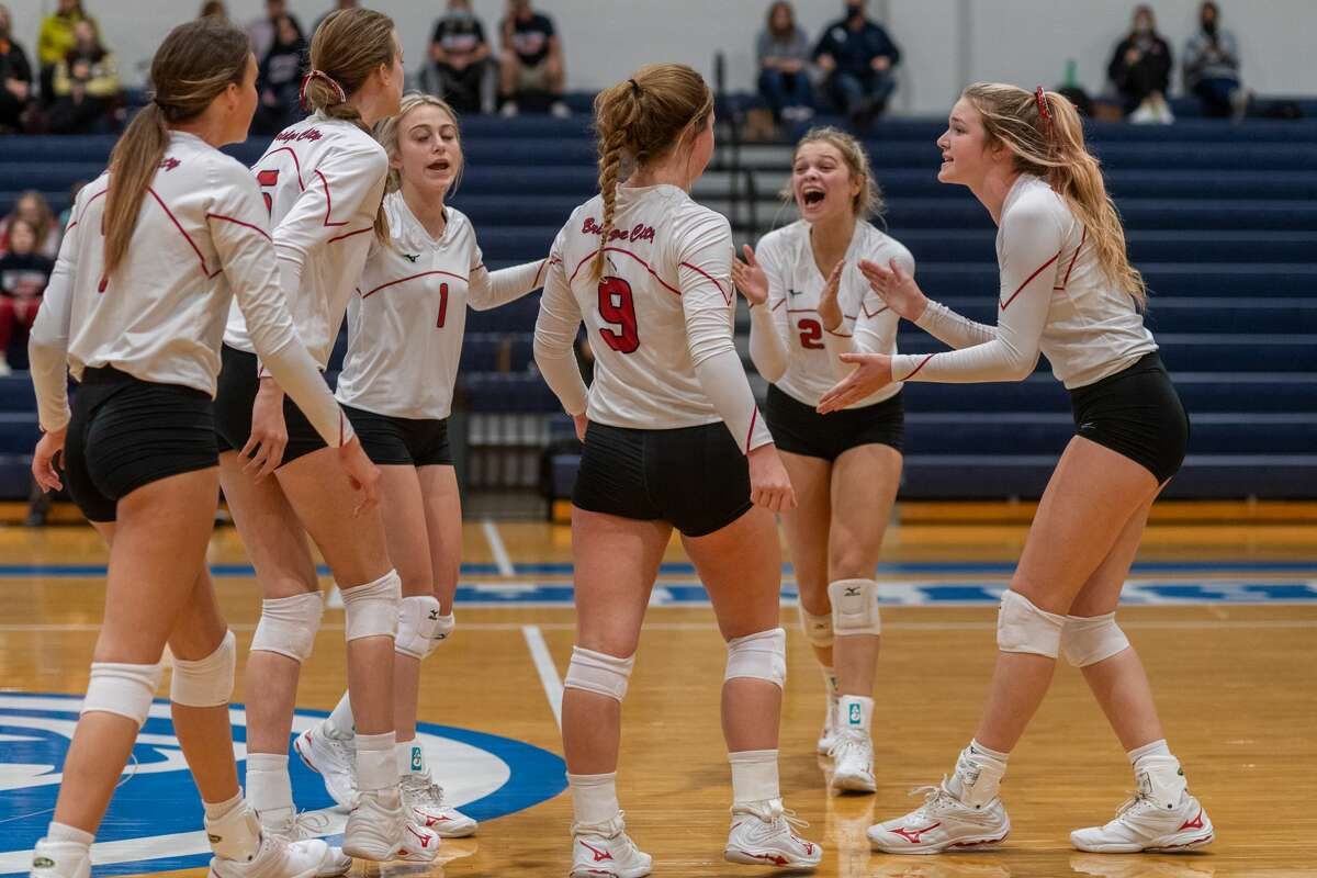Lady Cardinals celebrate a point in the second set. The Lady Cardinals of Bridge City took down the Lady Hawks of Hardin-Jefferson in 4 sets on Thursday night in the bi-district volleyball match at Buna High School. Photo made on October 29, 2020. Fran Ruchalski/The Enterprise