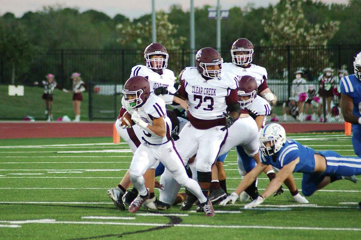 Clear Creek's Jeremiah Crum (3) picks his way through the Clear Springs defense Thursday, Oct. 29 at Challenger Columbia Stadium.