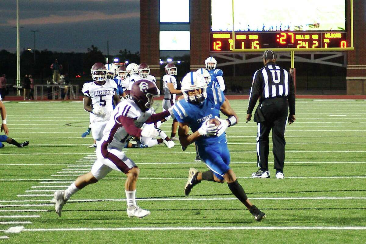 Clear Springs' Noah Thomas (3) pulls down a pass and sprints into the end zone against Clear Creek Thursday, Oct. 29 at Challenger Columbia Stadium.