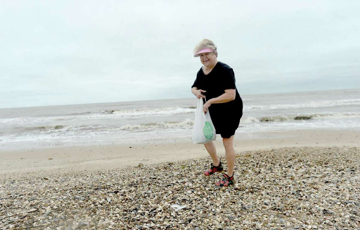 Patti Castille searches for treasures washed up in the wake of high tides and churning Gulf waters on the Bolivar Peninsula Wednesday. Castille has been a resident of the peninsula for 10 years and says her family stayed put this week as Tropical Depression Beta made its way up the coast.