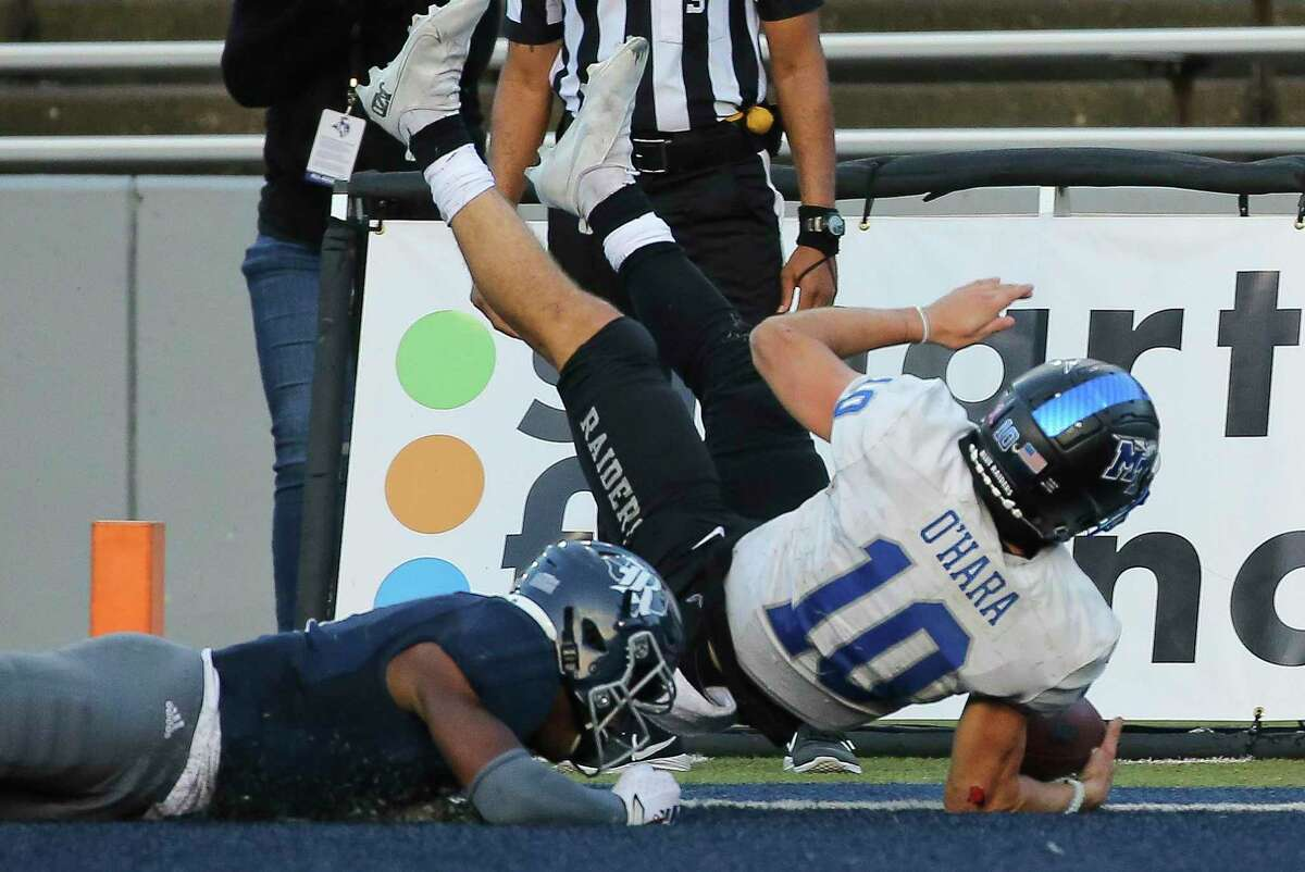 A tough afternoon for Rice's defense ended when Middle Tennessee quarterback Asher O'Hara (10) scored the decisive touchdown in the Blue Raiders' 40-34 double-overtime victory last Saturday at Rice Stadium.