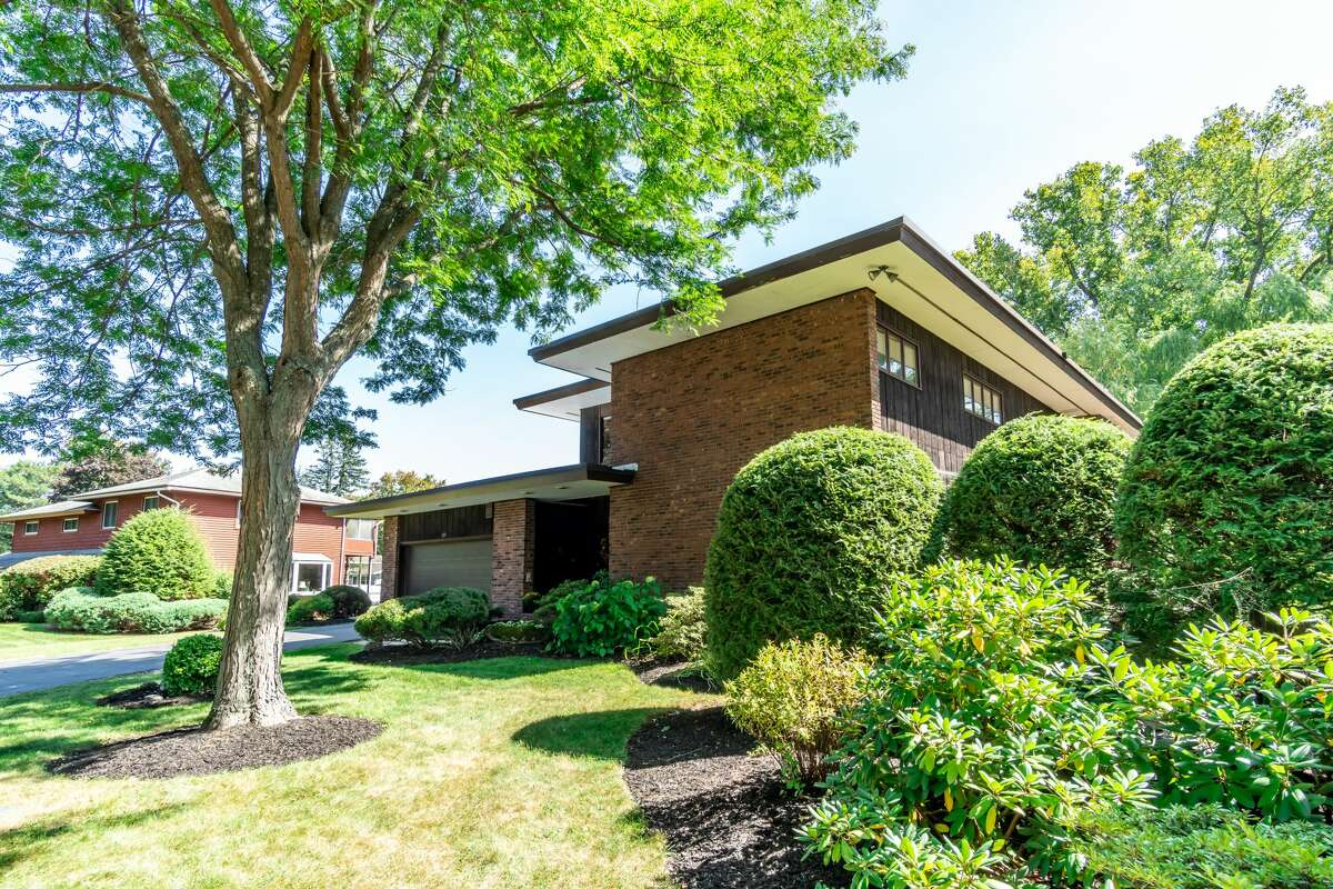 Built in 1962, this 4,200-square-foot home at 123 Pinehurst Ave., Albany has a throwback vibe, an curved fireplace, four bedrooms, 3 1/2 bathrooms and an in-ground pool. Taxes: $14,585. List price: $429,000. Contact listing agent Steven Girvin of Howard Hanna at 518-852-1315. https://realestate.timesunion.com/listings/123-Pinehurst-Av-Albany-NY-12203-MLS-202028918/44998679
