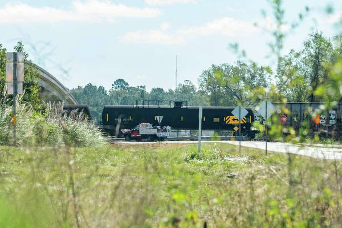 Train cars that didn't derail stand waiting under the bridge to be moved. A train derailed near Highway 62 and FM1130 in Mauriceville Thursday morning. Photo made on October 29, 2020. Fran Ruchalski/The Enterprise