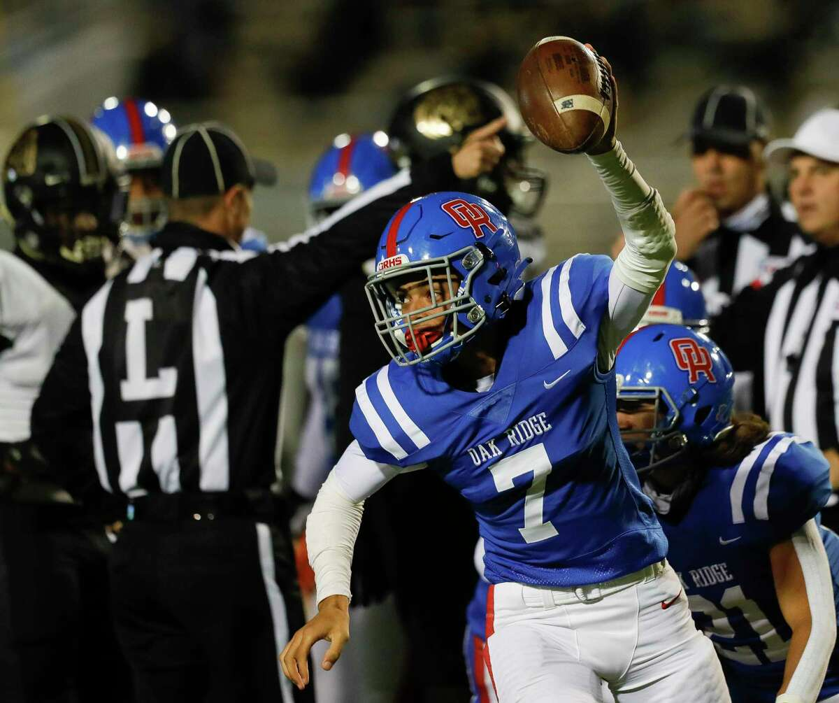 Oak Ridge quarterback Sammy Keith (7) reacts after recovering a fumble by Conroe running back Conroe Zayden Kimple during the second quarter of a District 13-6A high school football game at Woodforest Bank Stadium, Thursday, Oct. 29, 2020, in Shenandoah.