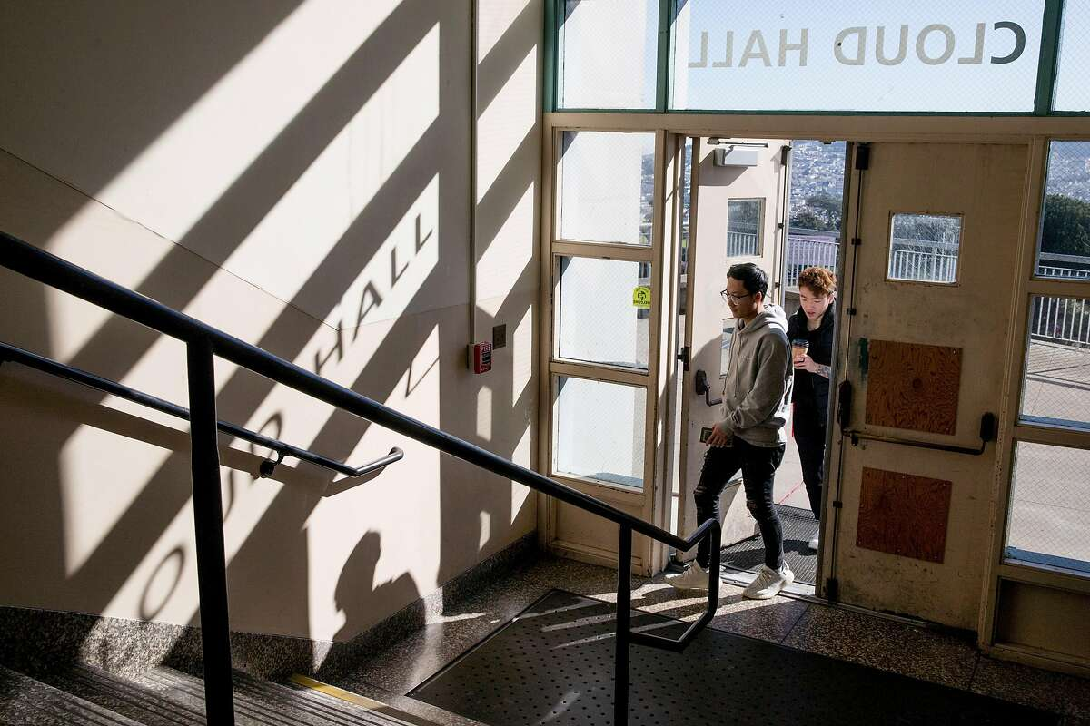 Students enter Cloud Hall through damaged doors at City College of San Francisco's Ocean Campus in San Francisco, Calif. Wednesday, February 12, 2020. City College of San Francisco administration is asking voters to approve Prop A, an $845 million bond measure for building repairs, in the upcoming March election.