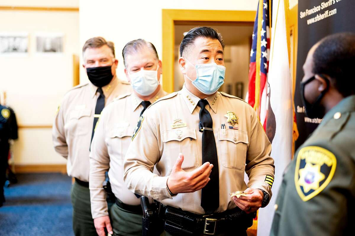 San Francisco Sheriff Paul Miyamoto speaks with a new sheriff's deputy during a pinning ceremony in San Francisco City Hall. Proposition D would add more oversight and transparency to the San Francisco Sheriff's Office.