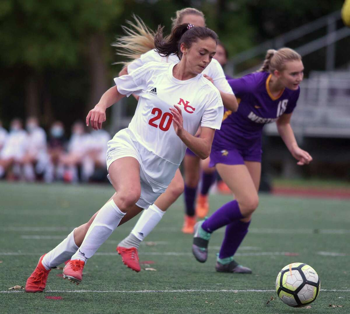 New Canaan's Emma Schuh (20) breaks away with the ball during the Rams' girls soccer game at Westhill High School in Stamford on Tuesday, Oct. 27, 2020.