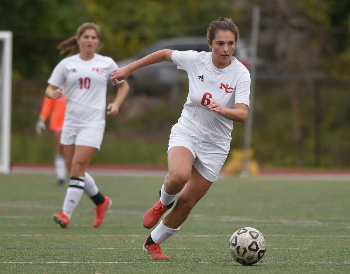New Canaan's Kaleigh Harden (6) brings the ball up the field during the Rams' girls soccer game at Westhill High School in Stamford on Tuesday, Oct. 28, 2020.