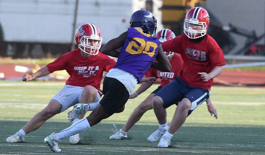 The New Canaan defense tries to stop a Westhill player during a 7-on-7 football game in Stamford on Friday, Oct. 9, 2020. Photo: Dave Stewart / Hearst Connecticut Media / Hearst Connecticut Media