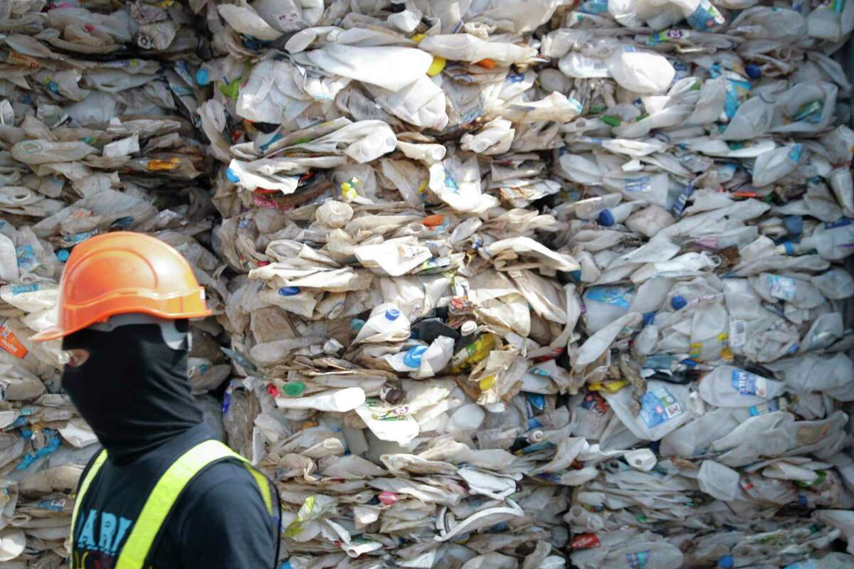 This file photo shows a container filled with plastic waste in Port Klang, Malaysia. A new study shows that the United States is contributing more to the world's plastic waste problem than estimated earlier.