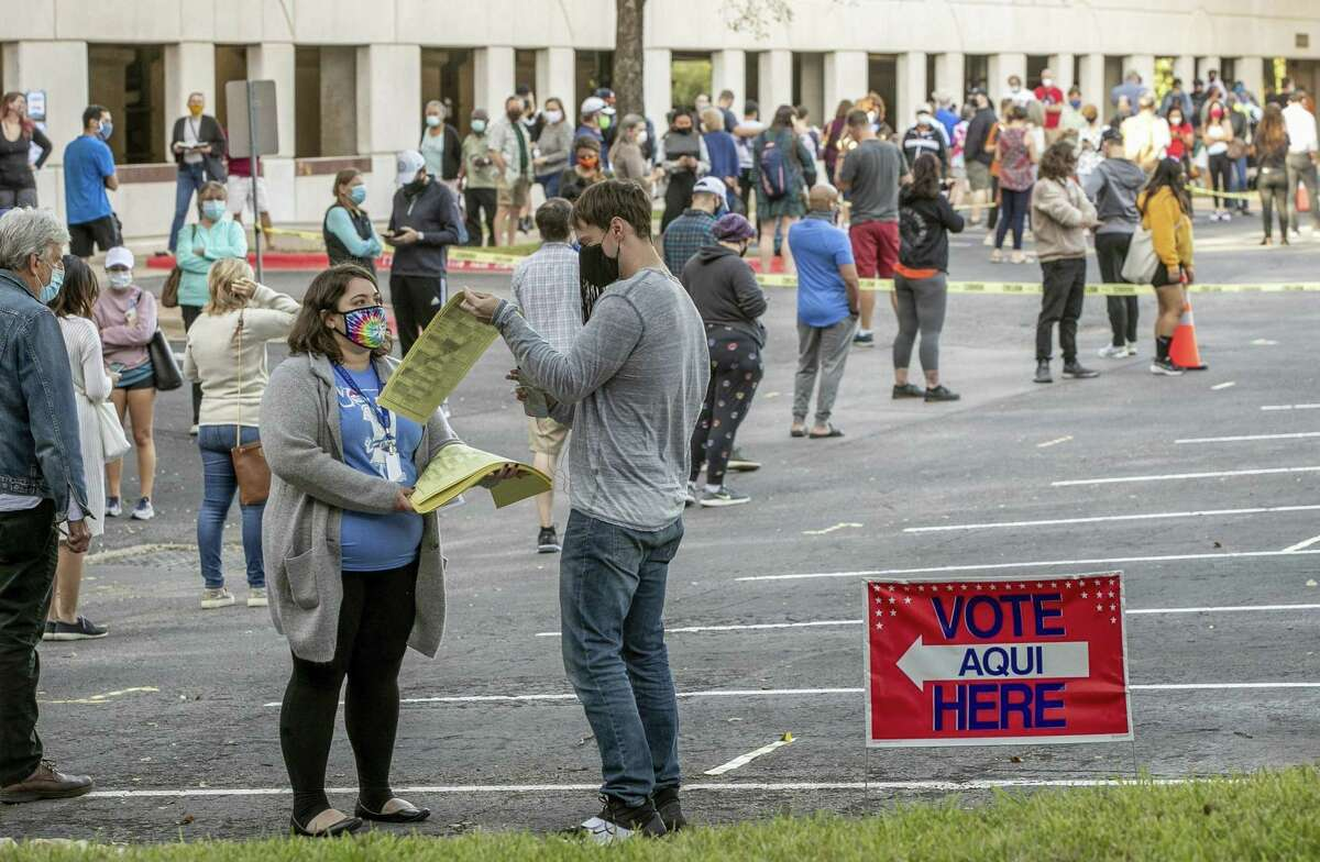 People wait in a long line on October 13, 2020, to vote at an early voting location at the Renaissance Austin Hotel in Austin, Texas. (Jay Janner/Austin American-Statesman/TNS)