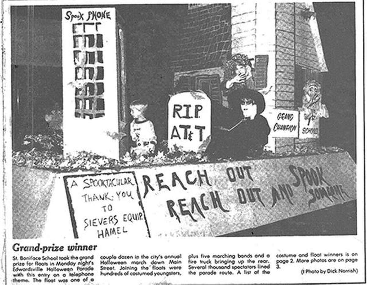 """These students from St. Boniface Catholic School took a popular telephone ad campaign and changed it to suit their float during the 1983 Halloween Parade. For those too young to recall, the real AT&T ad tagline was, """"Reach Out, Reach Out and Touch Someone."""""""