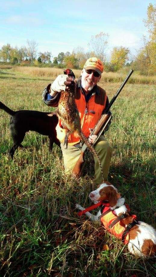 "Outdoors writer Steve Griffin and his Brittany, ""Beanbag,"" are pictured with a hard-earned rooster pheasant taken on opening morning on Tom Lounsbury's farm. (Tom Lounsbury/Hearst Michigan)"