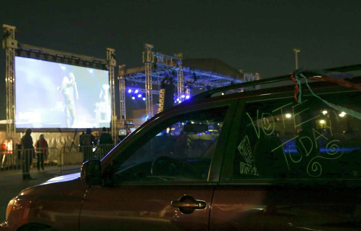 Attendees stay in the cars during a concert hosted by MOVE Texas at NRG in Houston on Thursday, Oct. 29, 2020.
