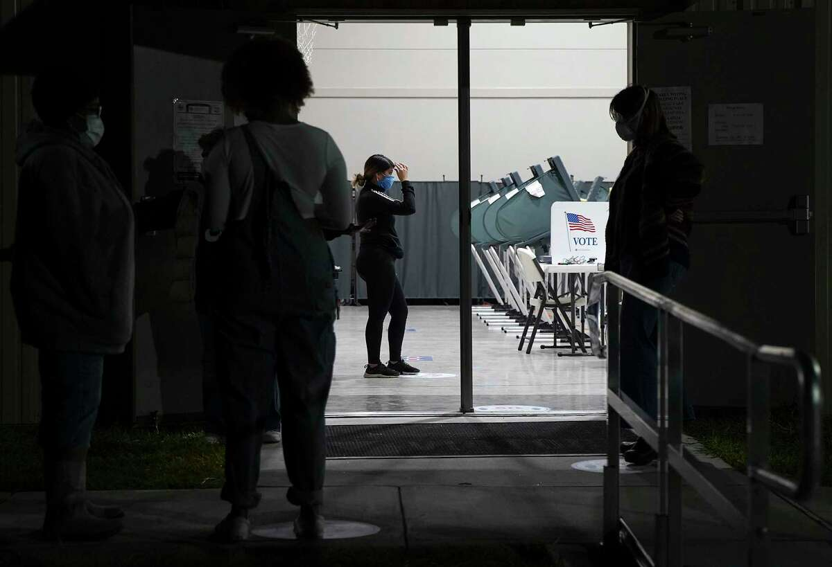 Voters wait outside Victory Houston polling station in Houston on Friday, Oct. 30, 2020. The location was one of the Harris County's 24-hour locations.