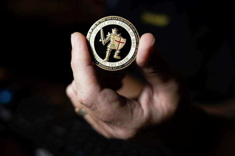 A challenger coin as being held by Chief Shannon Sharp acts as a good energy token for officers at the Patton Village Police Department, Thursday, Oct. 29, 2020. Photo: Gustavo Huerta, Houston Chronicle / Staff Photographer / 2020 © Houston Chronicle