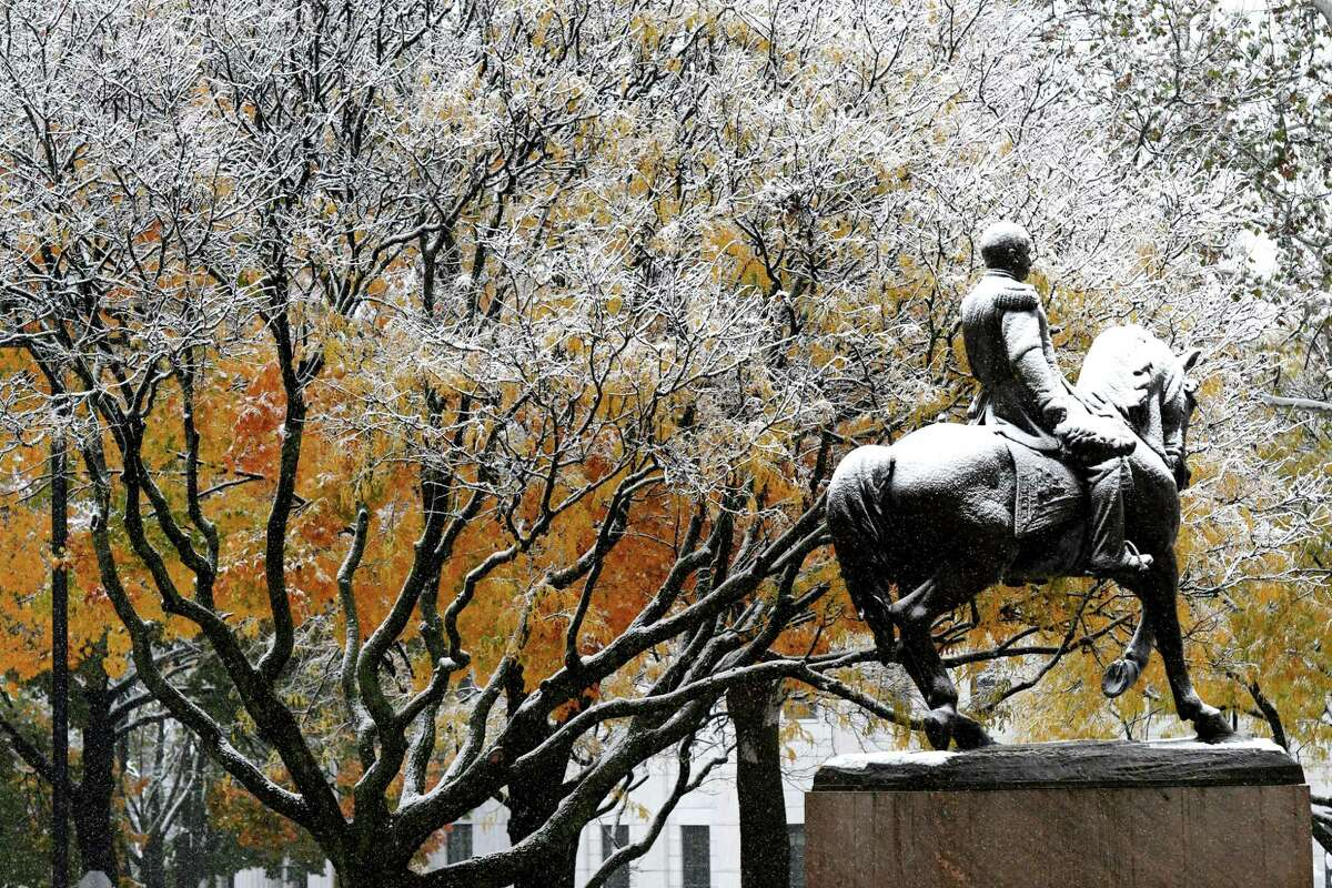 The Capitol grounds are decorated with snow as the first snowfall of the season arrives in the Capital Region on Friday morning, Oct. 30, 2020, in Albany, N.Y. (Will Waldron/Times Union)
