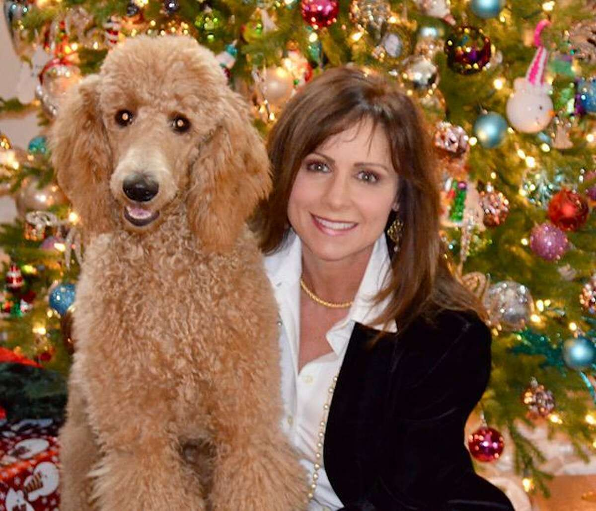 Psychologist Alicia Snow says that pets can help improve mood for people who may be struggling emotionally during the pandemic. Snow was the guest speaker at the Greater Tomball Area Chamber of Commerce Health Wellness Alliance meeting Oct. 27.