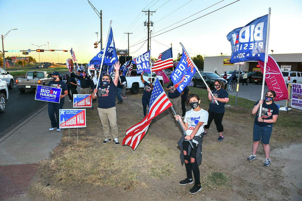 """Supporters of presidential candidate Joe Biden gather at the intersection of Palo Blanco St. and Zapata Highway, Thursday, Oct. 29, 2020, during the """"Everybody Vote Now!"""" Get Out the Vote Dance Challenge."""