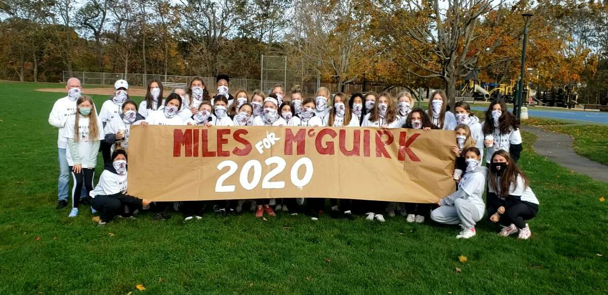 Group shot of participants with banner at MilesForMcGuirk 5K event at Foote Park in Branford on Sunday (Oct. 25). Event was a ALS fundraiser for former Branford field hockey coach Cathy McGuirk